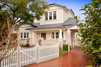 Love this white and cream Californian bungalow. Painting the barge boards charcoal looks great