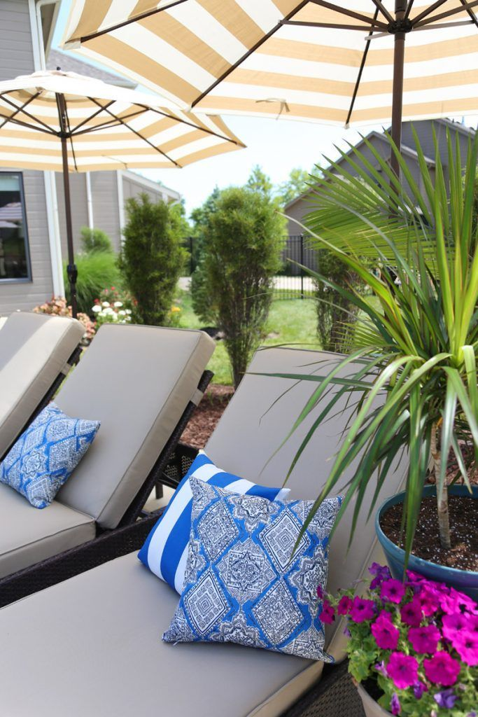 Serta Outdoor Collection Wicker Patio Chaise Lounge with Cushions and Striped Umbrellas in a Colorful Backyard via Life On Virginia Street