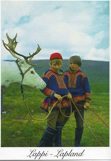 Finland / Sami boys with a reindeer