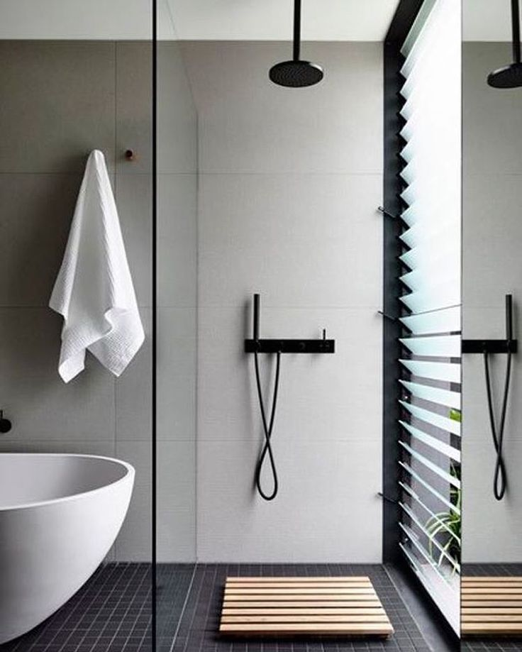 Color scheme and shower hardware. Simple glass panel.