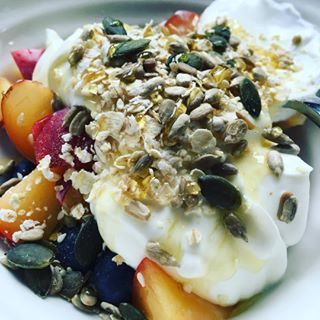 Trying for a healthy start after my over indulgent cooking course. Blueberries and plums with Greek yogurt, oats, seeds and honey #healthyworkfood #properfoodie