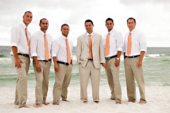 Groomsmen's Beach Wedding attire..  Khakki pants, white shirt with Rolled up sleeves and matching ties.