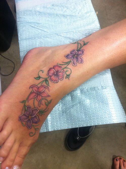 Flower Foot Tattoo. Not the flowers but the placement. http://pinterest.com/treypeezy http://twitter.com/TreyPeezy http://instagram.com/OceanviewBLVD http://OceanviewBLVD.com
