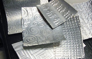 """Embossed aluminium reminds me of tin ceiling tiles. My birds have filled the existing birdhouses, so time to make more. I think I will emboss cats onto soda can aluminium to make """"tin roofs""""  for my new birdhouses."""