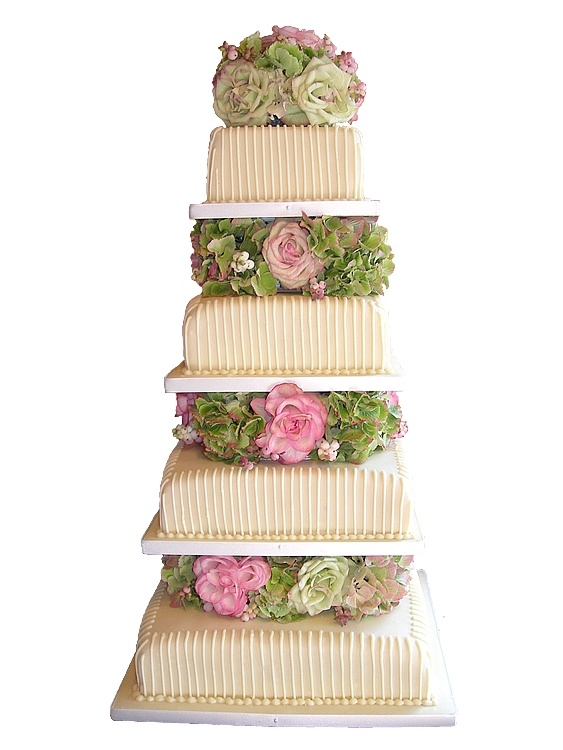 Smooth Belgian chocolate ganache with handpiped trellis work and beautiful fresh flowers.