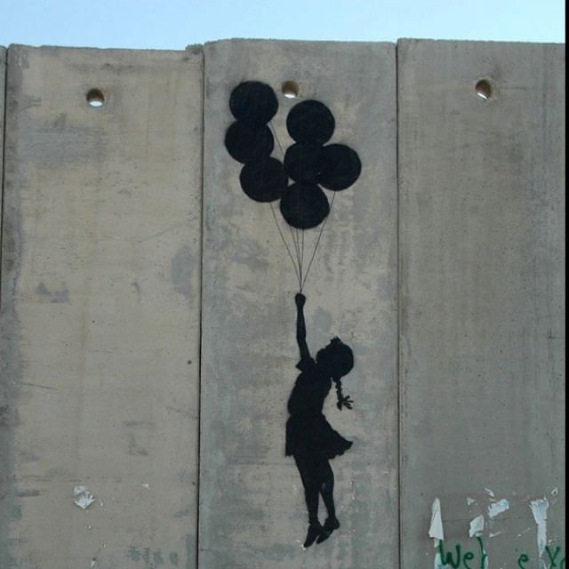 street art. stencil. Girl with balloons.