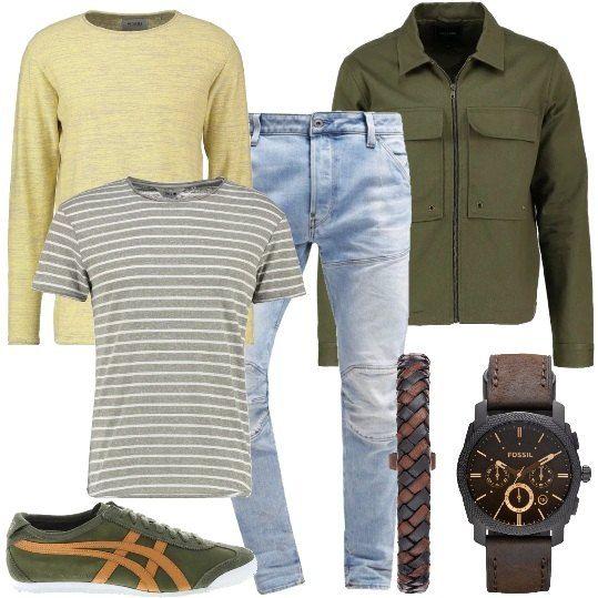 Completo adatto ad un contesto meno formale, curato nei particolari e nell'abbinamento dei colori. Giacca di jeans in verde, con tasche e chiusura a cerniera, maglione leggero, da abbinare ad una t-shirt con manica corta e fantasia a righe, jeans modello slim fit. Sneakers basse, scamosciate con dettaglio laterale a contrasto, orologio e bracciale della Fossil in pelle.