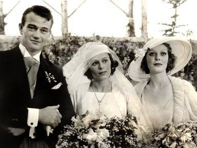 John Wayne, 1933, marries his first wife Josephine Saenz in Los Angeles - the guests celebrated at the home of Loretta Young (right).