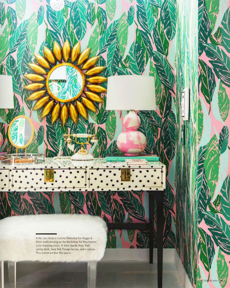 Glam Cave designed by Kelly Golightly as seen in California Homes Magazine: Modernism Week Palm Springs Show House Christopher Kennedy Compound featuring Justina Blakeney for Hygge & West banana leaf wallpaper, Kate Spade polka dot desk, Jana Bek brushstroke lamps, Lamps Plus mirror and stool. Photos by Laure Joliet