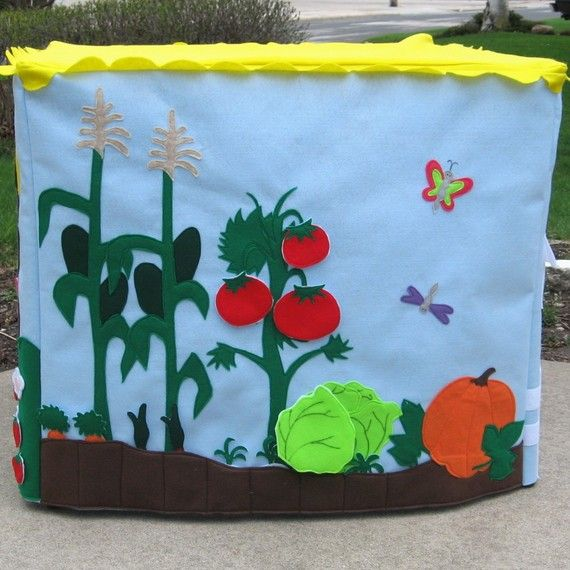 """I love the garden Idea since my boys love picking veggies out of my garden. Notice the pockets at the bottom where you can """"plant"""" root crops like carrots and radishes"""