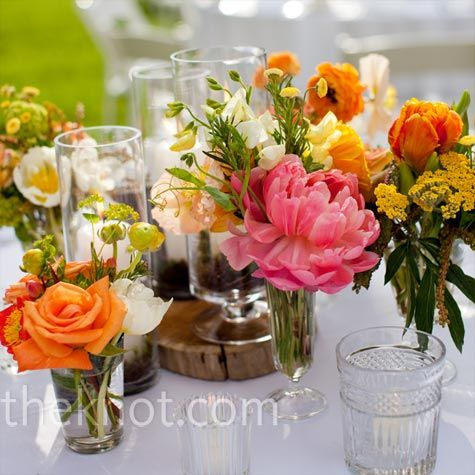 Organic tablescapes and a variety of blooms in eclectic vases bring a casual elegance and summery feel