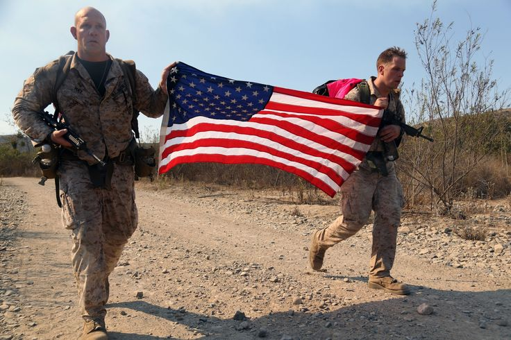 U.S. Marines Master Sgt. Christopher May, left, and Staff Sgt. Mark Rawson…