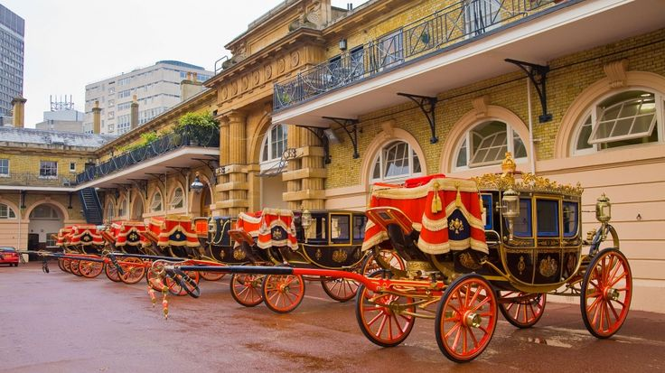 Coaches at the Royal Mews, Buckingham Palace - first mews was established shortly after George III purchased Buckingham Palace in 1760 - it was remodled by John Nash in 1820 and by Queen Victoria in 1837