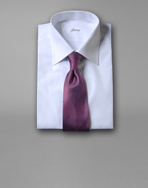 brioni.com|TIE WITH TAILORING MOTIF|Hand-made tie. Jacquard woven yarn-dyed silk with a sartorial two-color Prince of Wales design