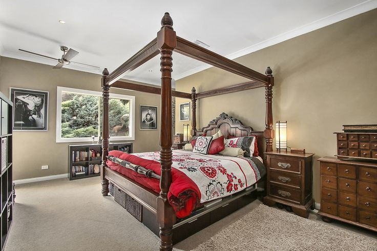 The master bedroom has solitude at one end of the house - and at the same time easy access directly out to the pool - fantastic in summer for a pre brekky dip on the hot days.  Behind the bed through to the ante room of ensuite and walkin robe.  A room of perfect size and feel.