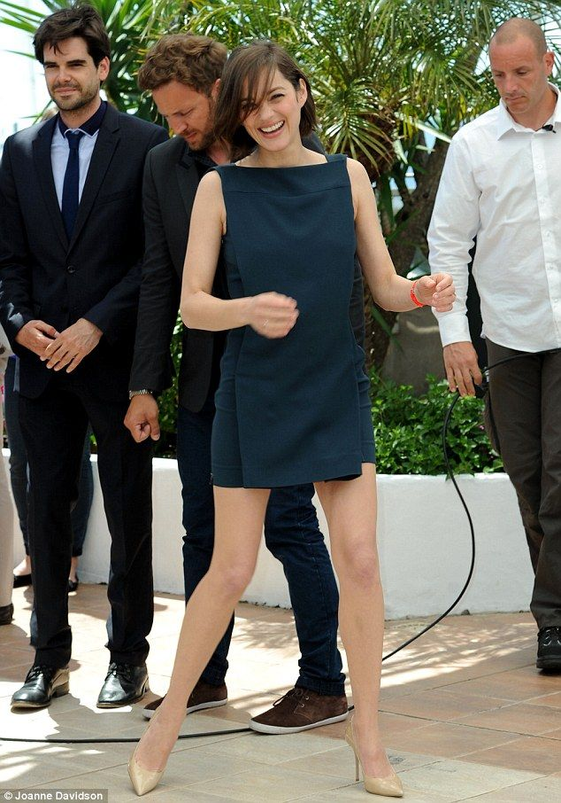 Something to smile about: Marion appeared to be having the time of her life as she strutted her stuff for the cameras