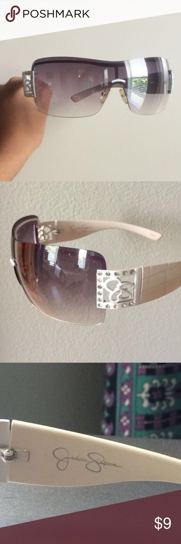 Jessica Simpson Sunglasses Rimless sunglasses with a Jessica Simpson logos surrounded by faux diamondsThe arms have snake skin looking impressions. Not worn much; minor impurities here and there. ✨Block the summer sun & look good doing it! Jessica Simpson Accessories Glasses