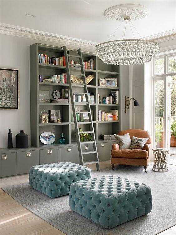 Trendy residence library with velvet pale blue chairs || Melody Patton…