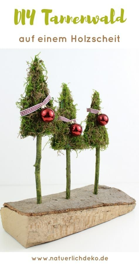 Tannenwald aus Moos auf einem Holzscheit – Nicole Schlegel