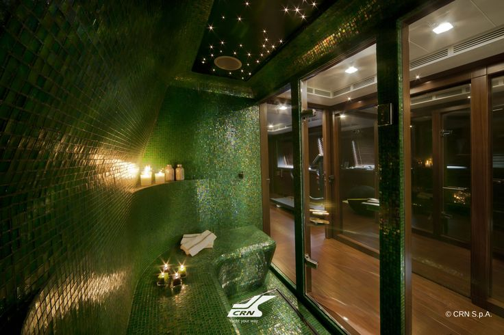 The spa area on the sun deck of the CRN M/Y J'Ade 60m is embellished with green mosaics and features a Turkish and a steam bath.