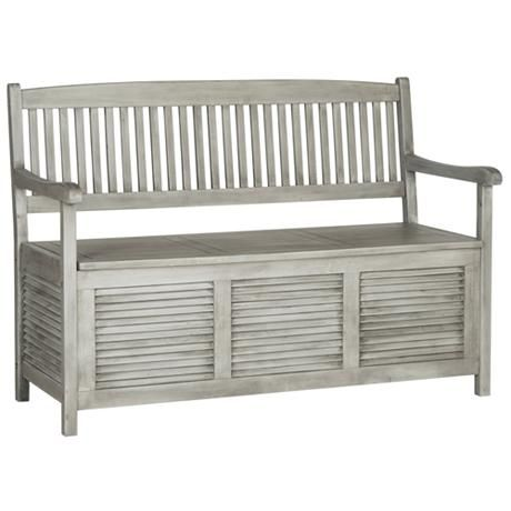 Stash toys or games in the base of this transitional outdoor storage bench with a stylish gray finish and slat back design.