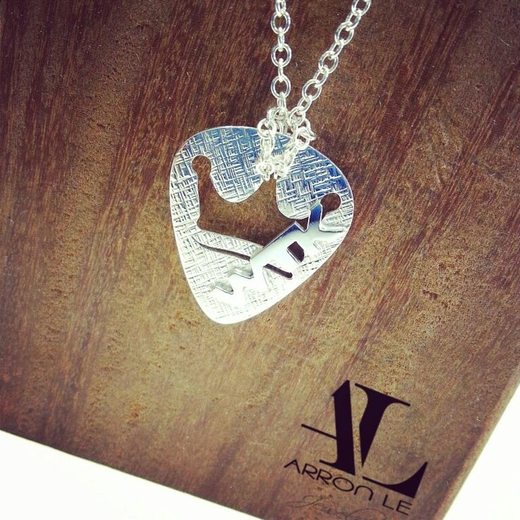 Guitar pick pendant. Big fan of the We the kings, as I watch them on you tube vlogs. Made from Argentium silver, designed and made by Arron Le . Email: ArronLeJewelry@gmail.com