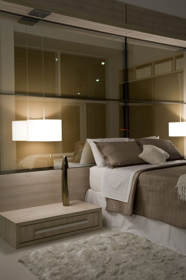 .Great glass wall, needs headboard - small modern side tables off the floor