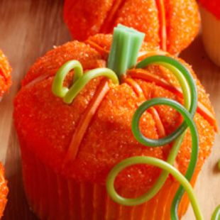 This project bridges the holidays and makes a terrific dessert centerpiece for gatherings from Halloween to Thanksgiving. The patch is made from both standard size and mini cupcakes baked in white or orange liners. Cupcakes are topped with a bonnet of orange frosting. The icing is rolled in orange sugar and the ribs are shaped by pressing a bamboo skewer into the frosting. The patch is finished off with licorice for stems and tendrils. Then pick your favorite and start eating!