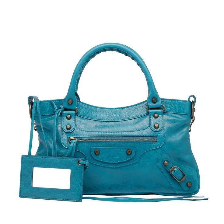 Check out Balenciaga First at http://www.balenciaga.com/en_US/shop-products/accessories/women/handbags/classic/balenciaga-first_804972678.html