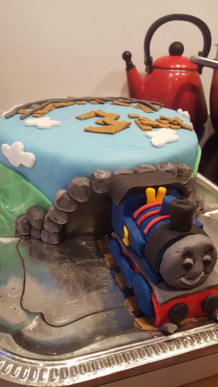 Thomas tog kage