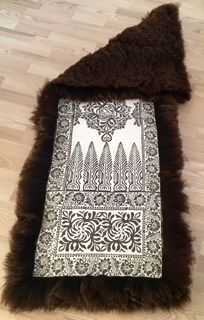 Sheep skin rug for a bench or a chair