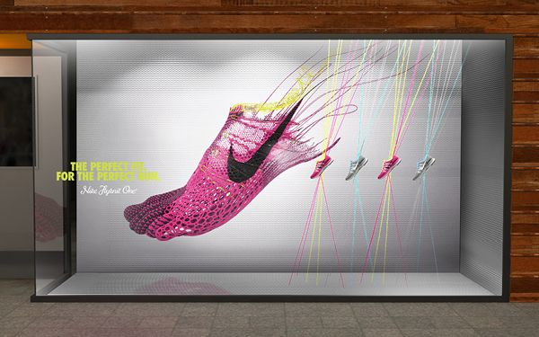 by Joe Stitzlein Z - Very clever design, creates the image that the shoes are built directly around, and for the foot, the detail of the lines also shows the precision of this; emphasising the feeling of comfort and that Nike create shoes for 'you'.
