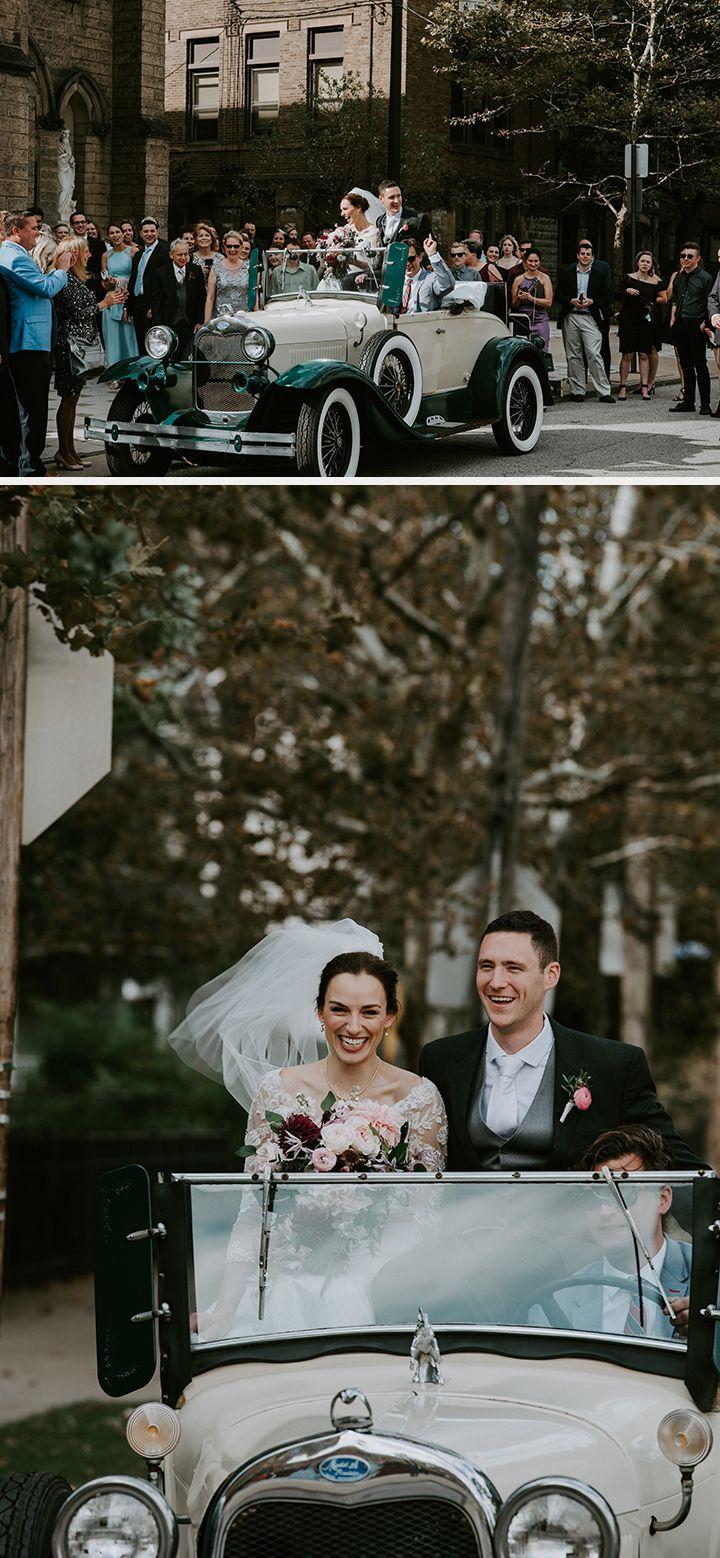 happy bride and groom in their wedding getaway car!