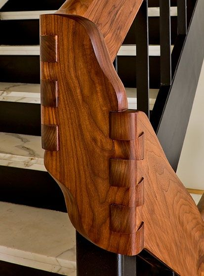 Amazing Dove-Tail joinery on the transition in this stairway hand-rail... Beautiful Craftsmanship and great detailing!