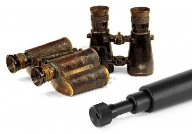Two old pair of binoculars and a modern telescope