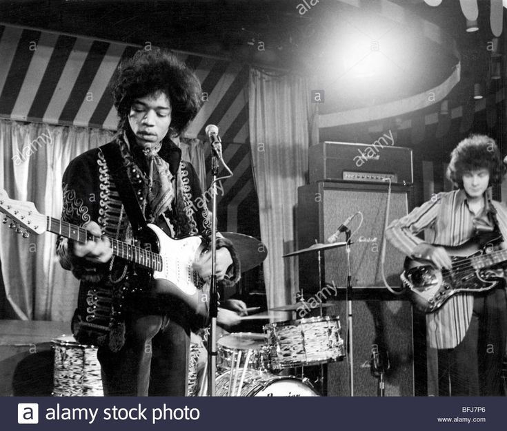 JIMI HENDRIX EXPERIENCE at the Marquee, Soho, for a German TV programme on 2 March 1967, Noel Redding at right. Photo Bob Baker Stock Photo