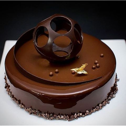 Beautiful mirror glaze and decorations. Entremet.