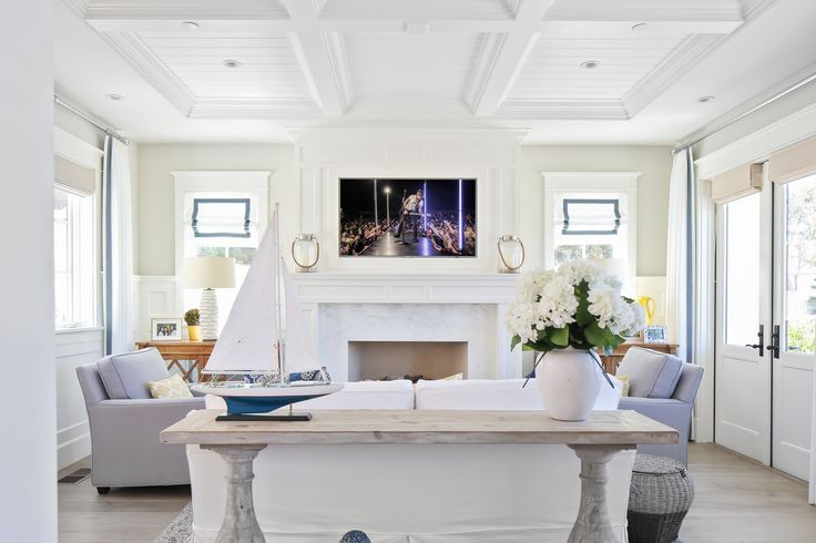 The natural lighting in this living room makes it seem a lot bigger than it actually is. We love the white and pastel accents as well as the classic colonial architecture. Combined, all of it creates a sense of mysticism not found in any living room!