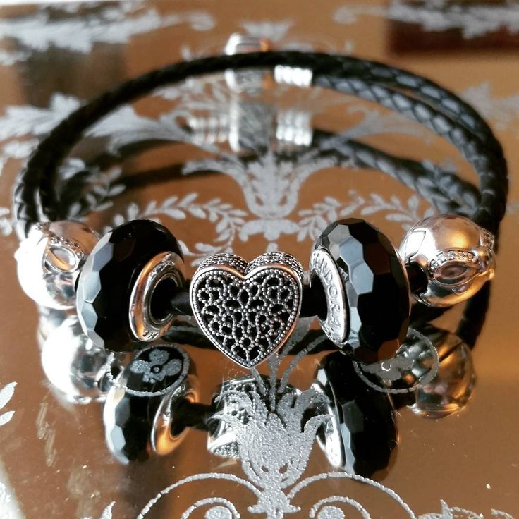 #PANDORATexas loves the sophisticated, edgy style of this black leather bracelet combined with faceted black Muranos and our Filled With Romance charm. #PANDORAcharm #PANDORAbracelet