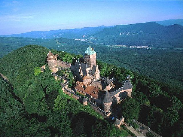 The château du Haut-Kœnigsbourg is nestled at a strategic location on a high hill overlooking the Alsatian plain in the Vosges mountains, France. It was used by successive powers from the Middle Ages until the Thirty Years' War when the castle was burned and pillaged by Swedish troops after a 52-day siege. After this the Château was left unused for a few hundred years and became overgrown by forest. In 1899 it was given to the German emperor Wilhelm II and rebuilt as it was on the eve of the…