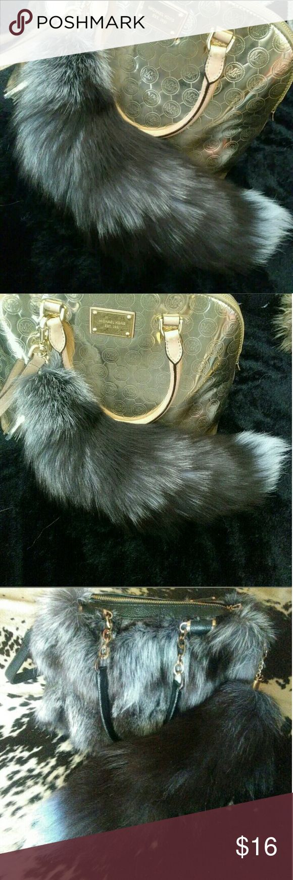 One Silver Fox Tail Keychain Genuine Real Fur Also on EBY @katisiepiersk0  One silver fox tail keychain. 10 available. All have been professionally tanned, brightened and toned with a pale blue/violet. You will receive one of the tails pictured. I have a seperate listing for all 10 if you would like to buy in bulk Accessories