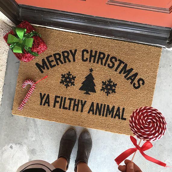 the Merry Christmas ya filthy animal doormat