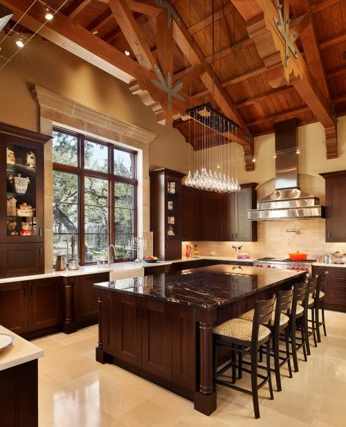 Rustic kitchen design ideas and decor, with large island and beamed ceiling