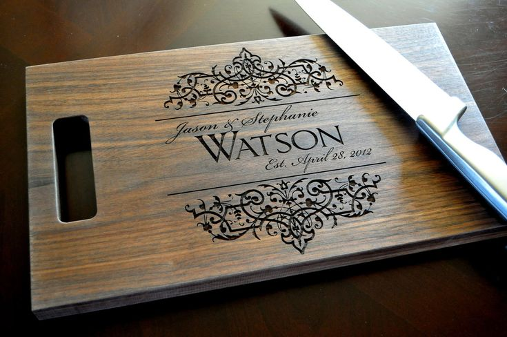 Personalized Cutting Board Laser Engraved Walnut 8x14 Wood Cutting Board. $34.00, via Etsy. Great wedding gift.