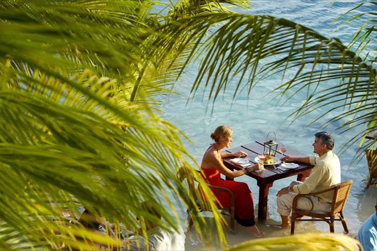 Enjoy this perfect weather in Aruba while eating your delicious dinner literally in the ocean!! {Picture from: https://www.facebook.com/funjetvacations}