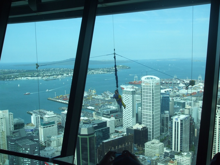 Bungy jumper dangling off the Auckland Sky Tower.