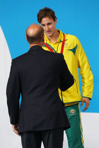 Silver medallist Cameron McEvoy of Australia shakes hands with Prince Edward; Earl of Wessex during the medal ceremony for the Men's 200m Freestyle Final at Tollcross International Swimming Centre during day two of the Glasgow 2014 Commonwealth Games on July 25, 2014 in Glasgow, Scotland.