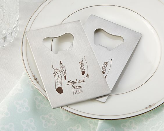 Personalized credit card bottle openers with a whimsical feather design make unique favors for a boho wedding!