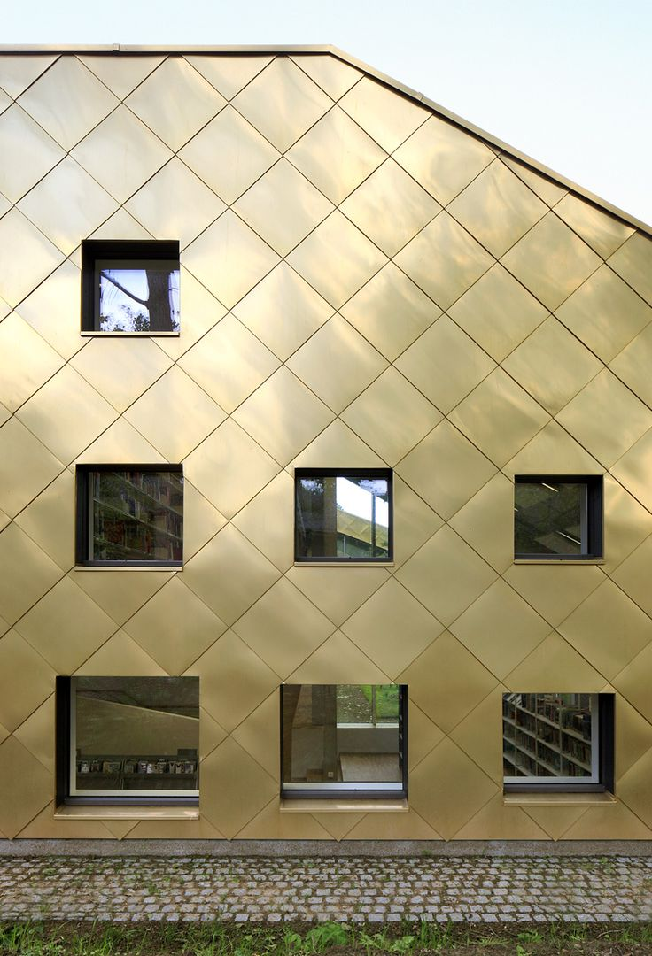 Golden copper alloy use to clad a new Library in Brussels by plus office architects.