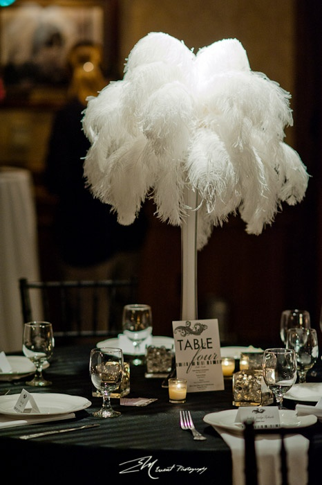 white ostrich feather centerpiece photo by edricmorales centerpiece by nixon events
